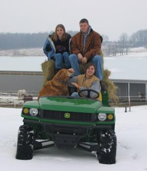 Work at Nature's Edge - image of staff on four wheeler